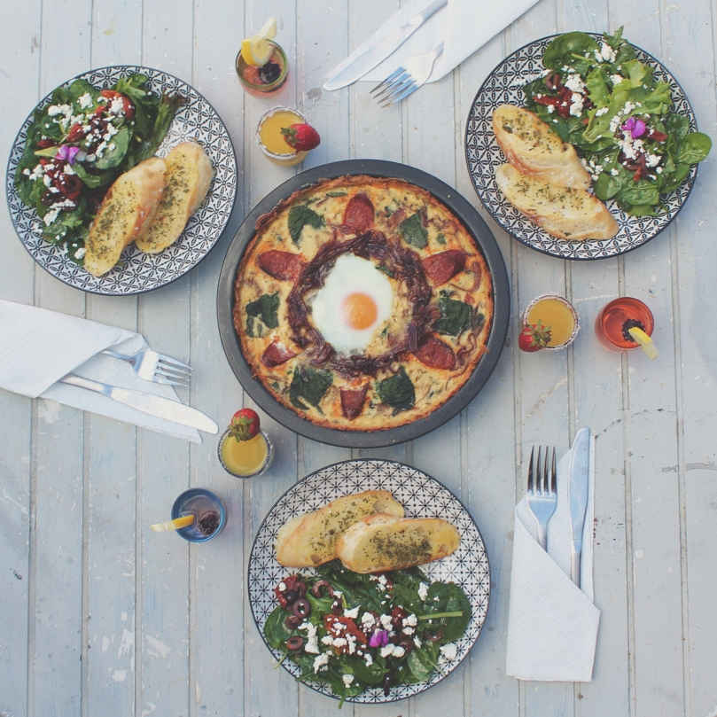 Potato Hash Crusted Breakfast Quiche with Caramelised Onion, Chorizo, Spinach, and Sunnyside Up Egg with Mixed Leaf Salad and Garlic Butter Bread