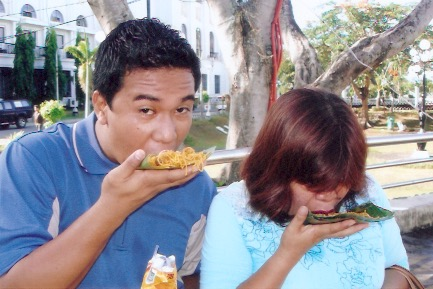 My Mom & Cousin eating Pancit Lucban the traditional way