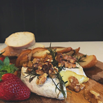 Baked Brie with Rosemary, Honeyed Pear, and Walnuts